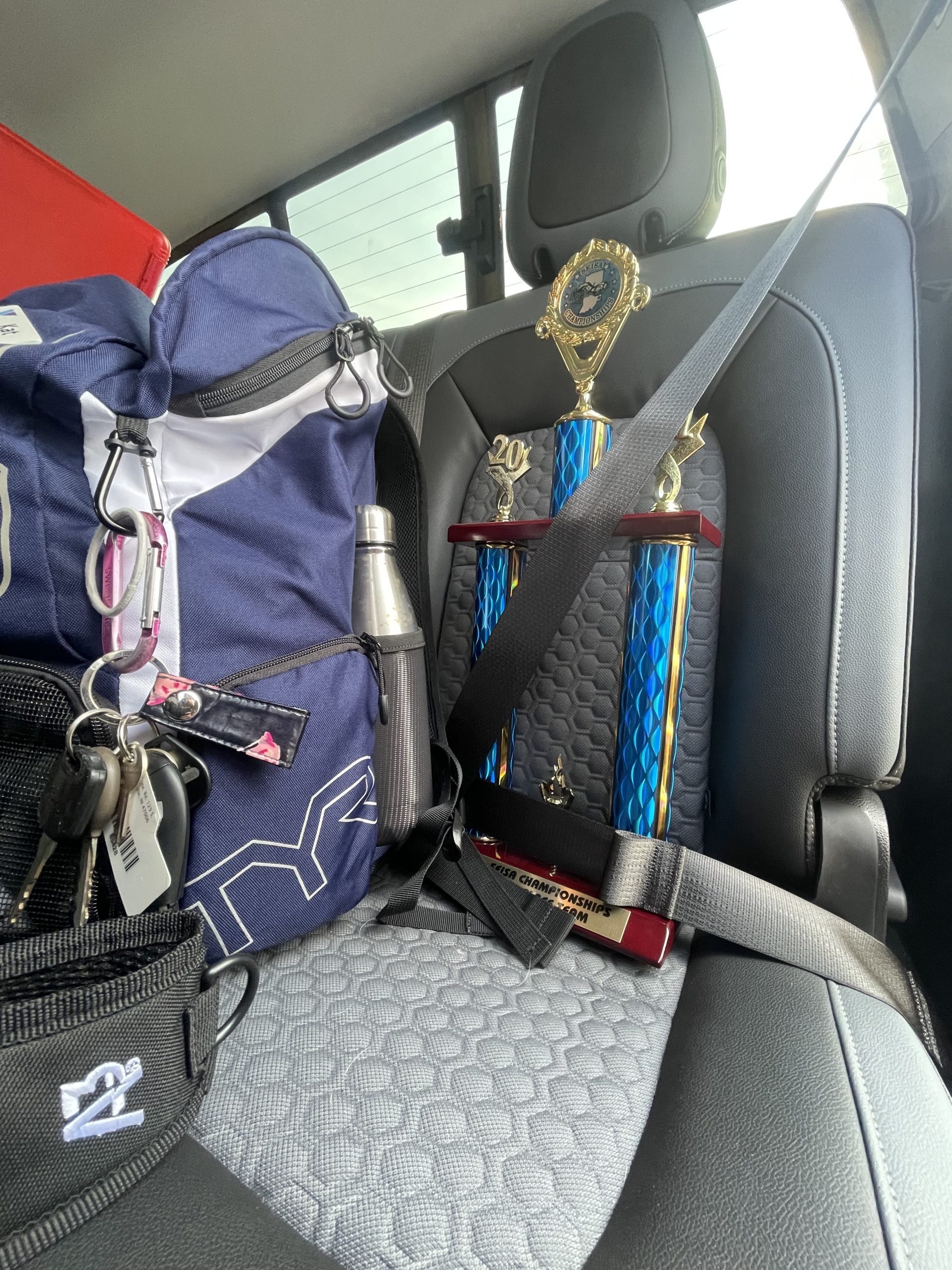 S.E.I.S.A. second place trophy strapped into back seat of the coach car