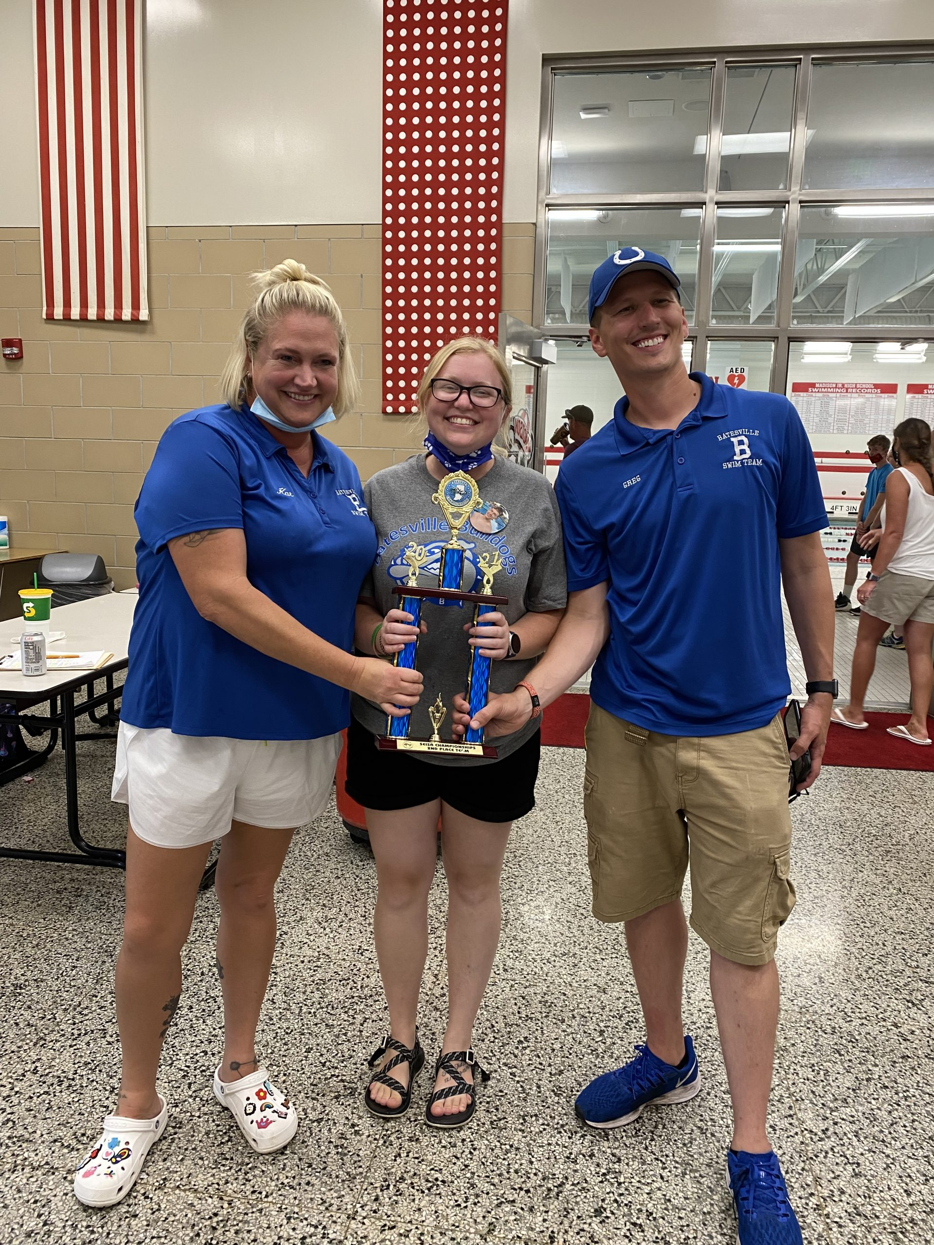 Batesville Swim Team Coaches, Kat Bryan, Sidney Howard and Greg McMullen holding SEISA second place trophy